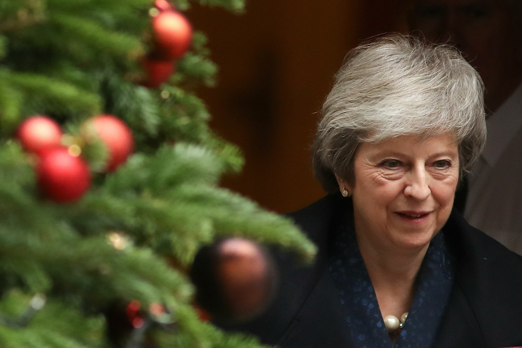 Britain's Prime Minister Theresa May leaves 10 Downing Street in central London on December 12, 2018 ahead of the weekly question and answer session, Prime Ministers Questions (PMQs), in the House of Commons.
