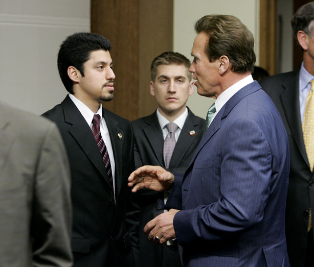 Gov. Arnold Schwarzenegger, right, talks with Victor Sanchez, President of the University of California Student Association after a higher education meeting held at the Capitol Sacramento, Calif., Wednesday, March 3, 2010. Schwarzenegger met with leaders of California's colleges and universities to discuss budget cuts that have left higher education in critical condition.