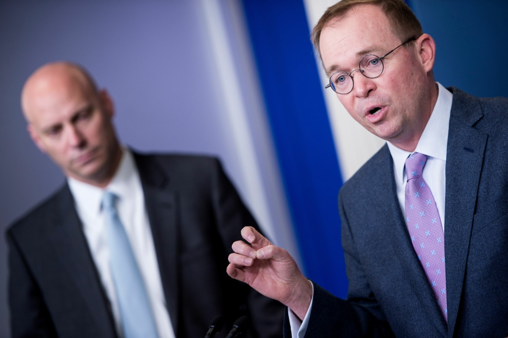 Director of Legislative Affairs Marc Short (L) listens while Office of Management and Budget Director Mick Mulvaney (R) speaks about the Consolidated Appropriations Act of 2018 at the White House March 22, 2018 in Washington, DC.