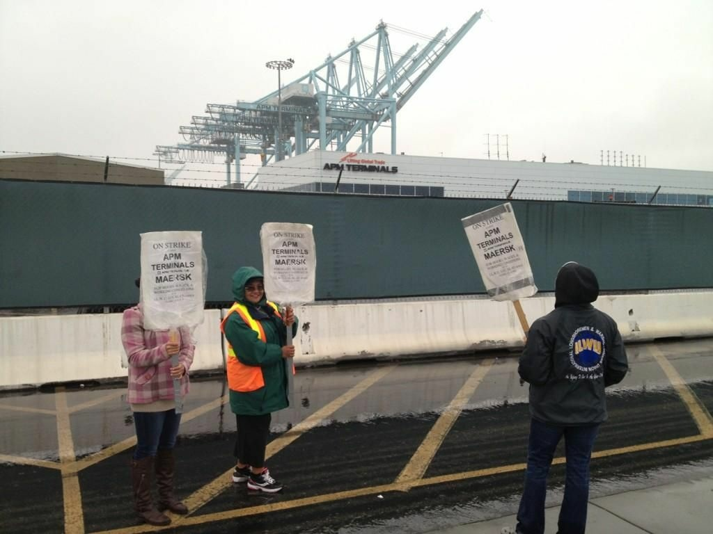 Striking clerical workers at Pier 400 walk the picket lines Thursday at the Port of Los Angeles.