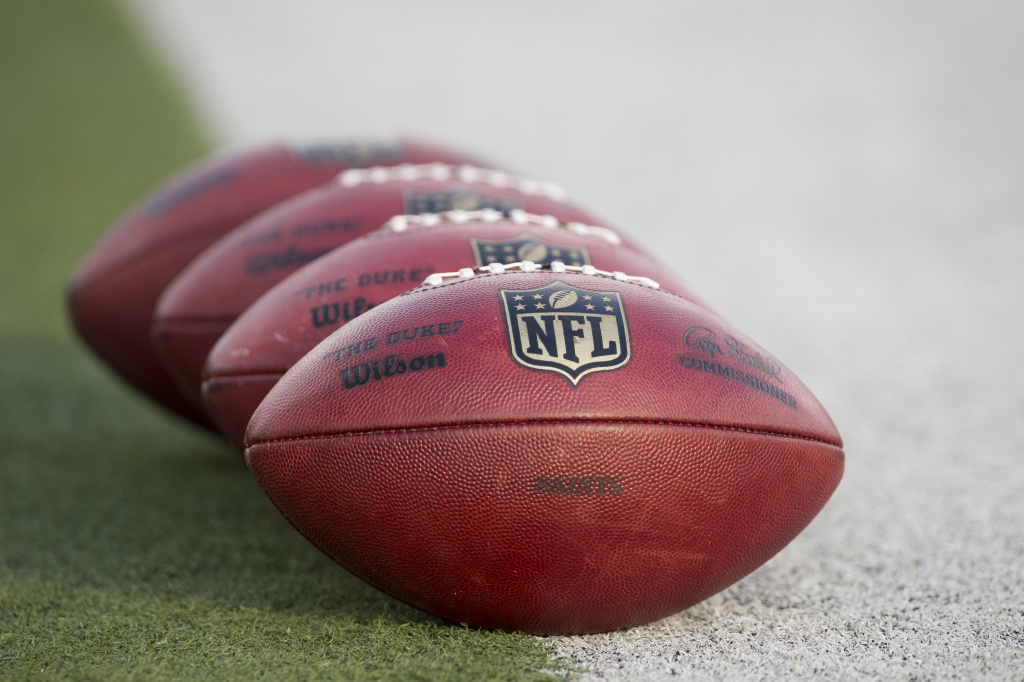 NFL owners on Tuesday approved the competition committee's proposal to snap the ball from the 15-yard line on points after touchdown to make them more challenging.
