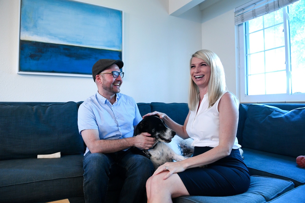 Colorado State Sen. Brittany Pettersen with her husband Ian Silverii and their dog Ollie, last August in their home in Colorado. Petterson, who gave birth to the couple's son this year, has lobbied hard to expand paid family and medical leave throughout the state.
