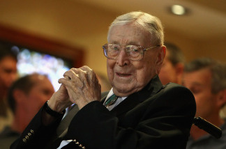Former UCLA college basketball coach John Wooden looks on during the John R. Wooden Classic match between the UCLA Bruins and the De Paul Blue Demons at Honda Center on December 13, 2008 in Anaheim, California.