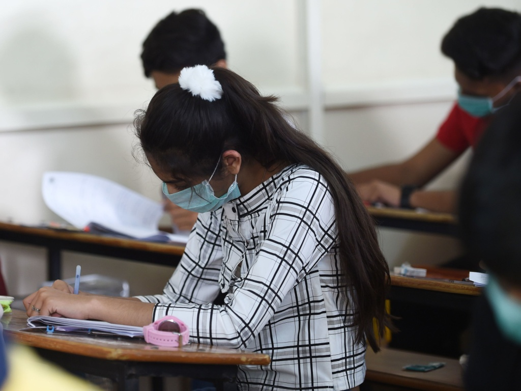 Students sit for an exam in Ahmedabad, India, on Thursday. In the nation's capital, New Delhi, all primary schools have been ordered closed until March 31 due to coronavirus concerns.