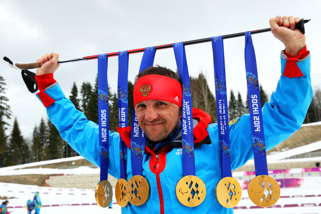 Roman Petushkov of Russia poses with the six gold medals won during the Sochi 2014 Paralympic Winter Games at Laura Cross-country Ski and Biathlon Center on March 16, 2014 in Sochi, Russia.