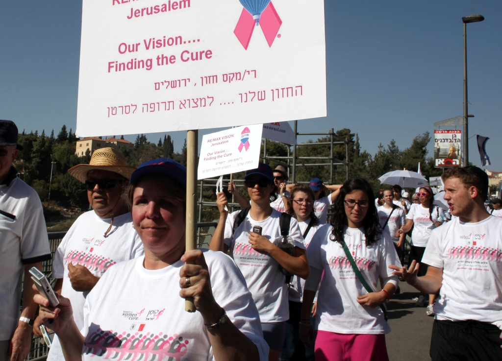 Israelis participate in a march organized by Komen for the Cure, the world's largest breast cancer charity, as they walk around the walls of Jerusalem's Old City as part of