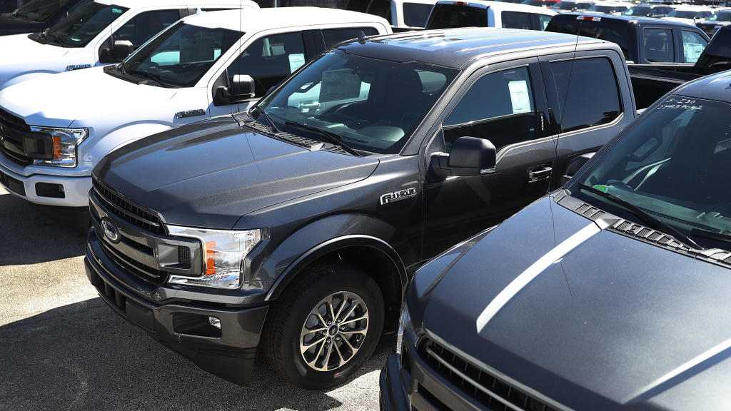 Ford F-150 pickup trucks are seen on Metro Ford's sales lot in Miami last October. The automaker had to temporarily halt production after a fire interrupted the supply of some parts.