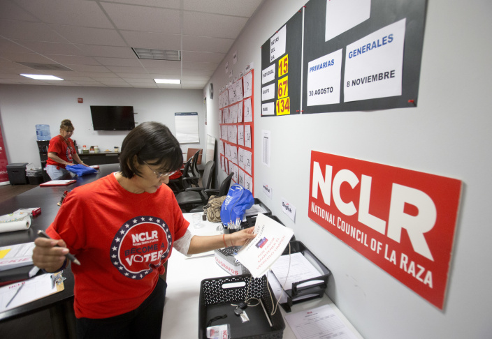 File photo: Canvasser Ana Mejia gathers her supplies at the offices of the National Council of La Raza (NCLR) the nation's largest Hispanic civil rights organization, Thursday, April 7, 2016, in Miami.