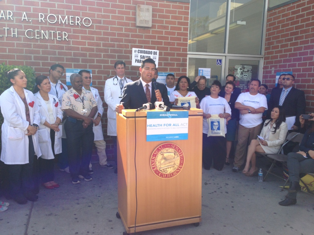 In this file photo, state Senator Ricardo Lara (D-Long Beach) holds a press conference to introduce SB 1005, the Health For All Act, which would subsidize health insurance for undocumented immigrants. Feb. 14, 2014. On Friday the Senate voted to put the bill on hold, a move that makes it harder for it to advance because it will require a two-thirds vote.
