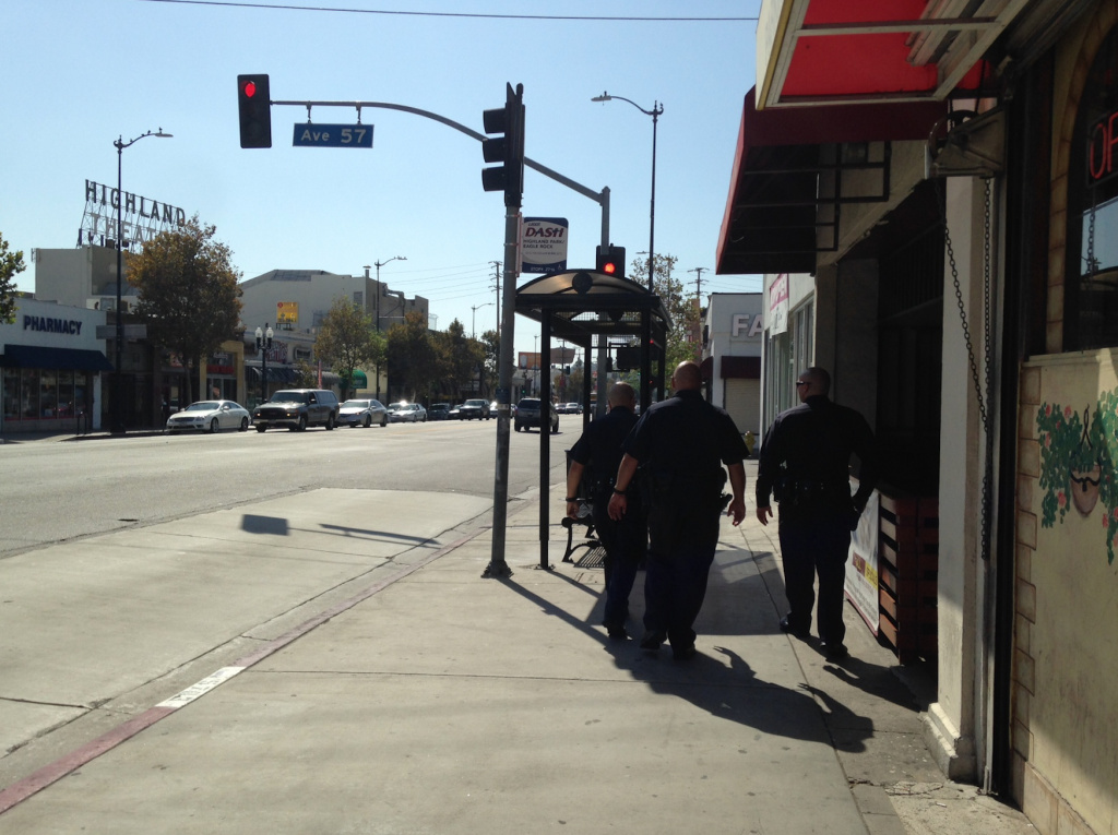 LAPD officers walk along North Figueroa Street in Highland Park. The new foot patrols, along a rapidly gentrifying stretch of Figueroa between Avenues 50 and 60, began about a month ago.