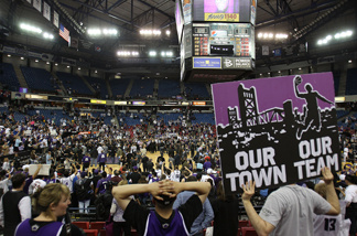 Fans of the Sacramento Kings hold up signs against the Los Angeles Lakers on April 13, 2011 at Power Balance Pavilion in Sacramento, California.