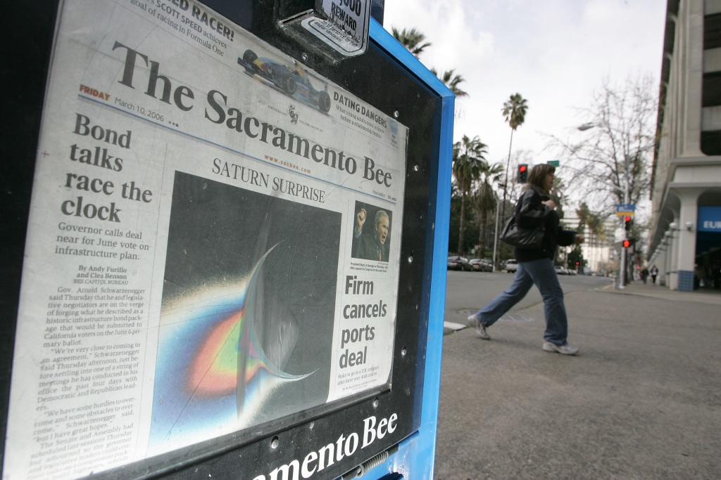 A woman walks by a Sacramento Bee newspaper rack March 10, 2006 in Sacramento, California.