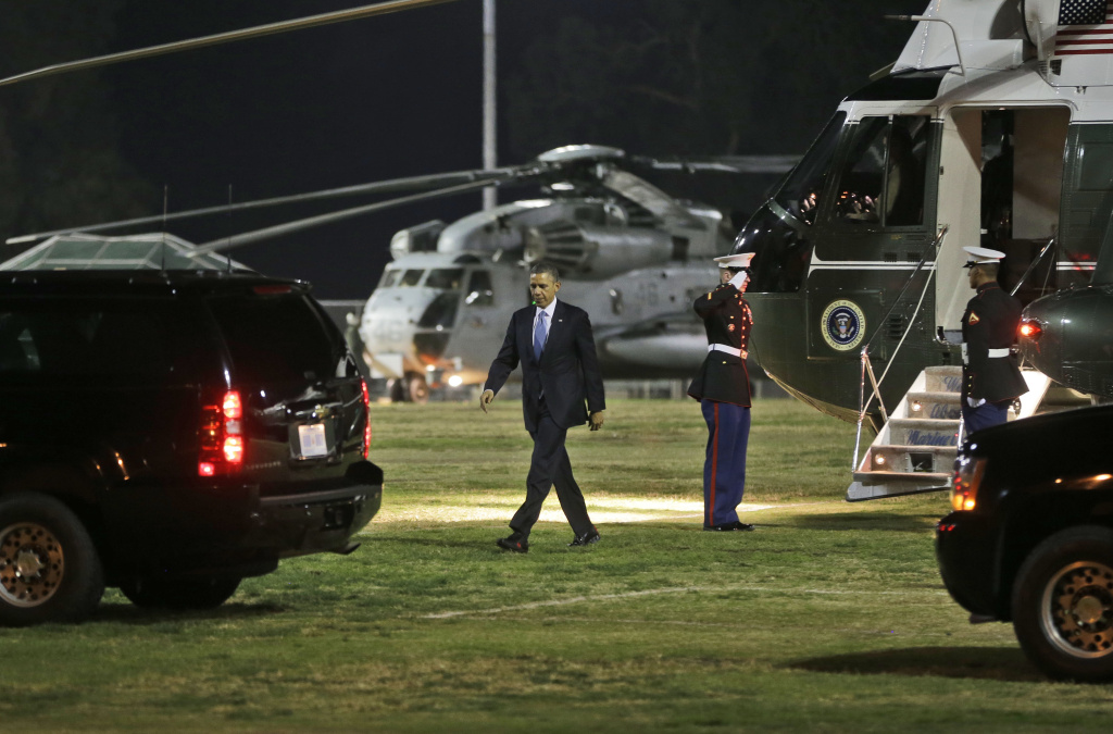 President Barack Obama walks to his vehicle following his arrival on Marine One helicopter Cheviot Hill Park in Los Angeles, Monday, Nov. 25, 2013. Obama was expected to deliver an address on the economy on Tuesday afternoon at DreamWorks Animation in Glendale, Calif.