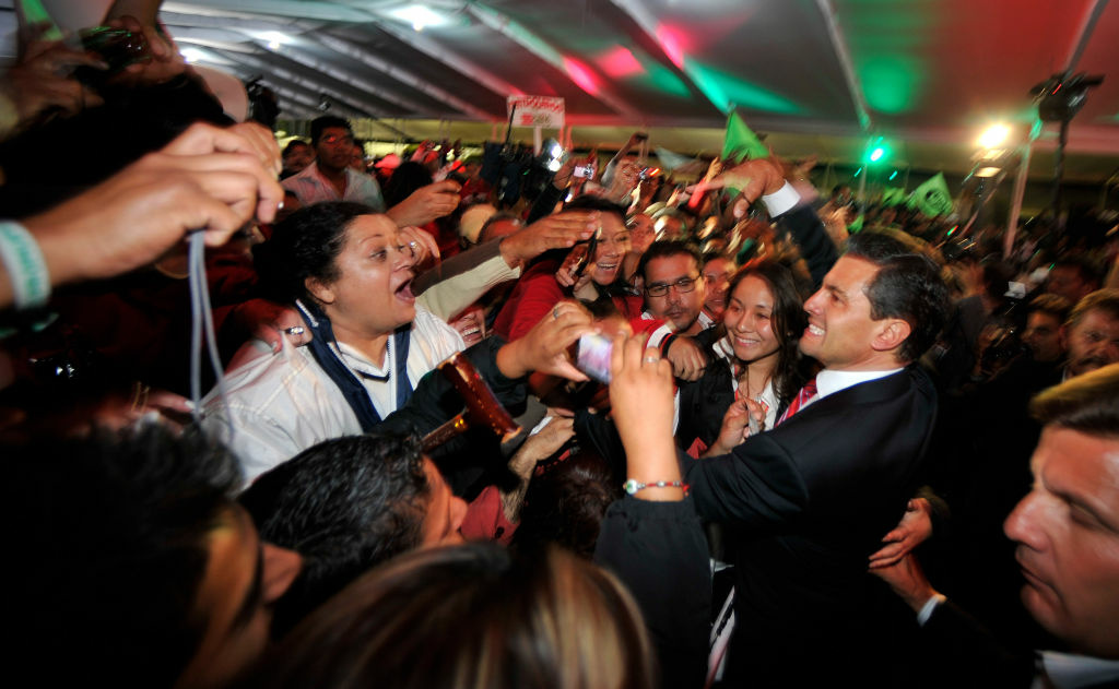 Presumed President-elect Enrique Pena Nieto of the Institutional Revolutionary Party (PRI) celebrates with supporters on July 2, 2012 in Mexico City, Mexico.