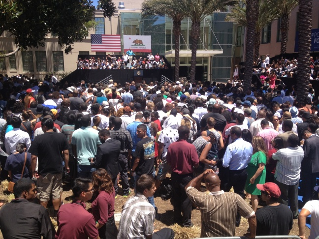 A crowd awaits the arrival of President Barack Obama in Stevens Square at Los Angeles Trade Technical College on Thursday, July 24, 2014.
