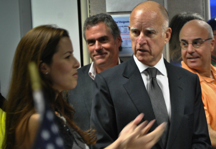 Governor Jerry Brown enters the The Mars Curiosity rover environmental monitoring station on August 22, 2012 at NASA's Jet Propulsion Laboratory.