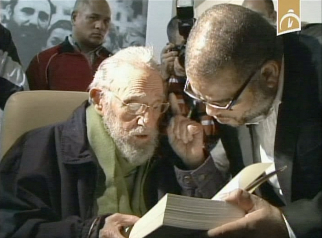 In this frame grab of video released by Cubavision, Cuba's former President Fidel Castro attends the inauguration of the cultural center, Studio Kcho Romerillo, Laboratory for Art, in Havana, Cuba, late Wednesday, Jan. 8, 2014. Castro made his first public appearance in nine months after last appearing in public in April 2013, when he attended the inauguration of Havana school. (AP Photo/Cubavision via APTN)