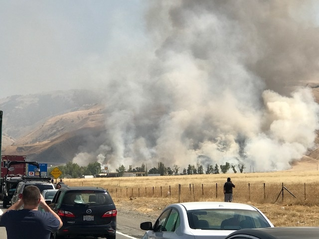 The big rigs that sparked a brush fire, shutting down the southbound Interstate 5 in the Grapevine on Thursday, Aug. 10, 2017.