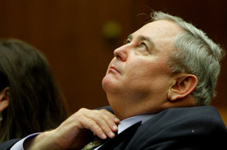 Former Bell City Manager Robert Rizzo listens to proceedings during his preliminary hearing on Wednesday, February 23, 2011 in Los Angeles Superior Court.