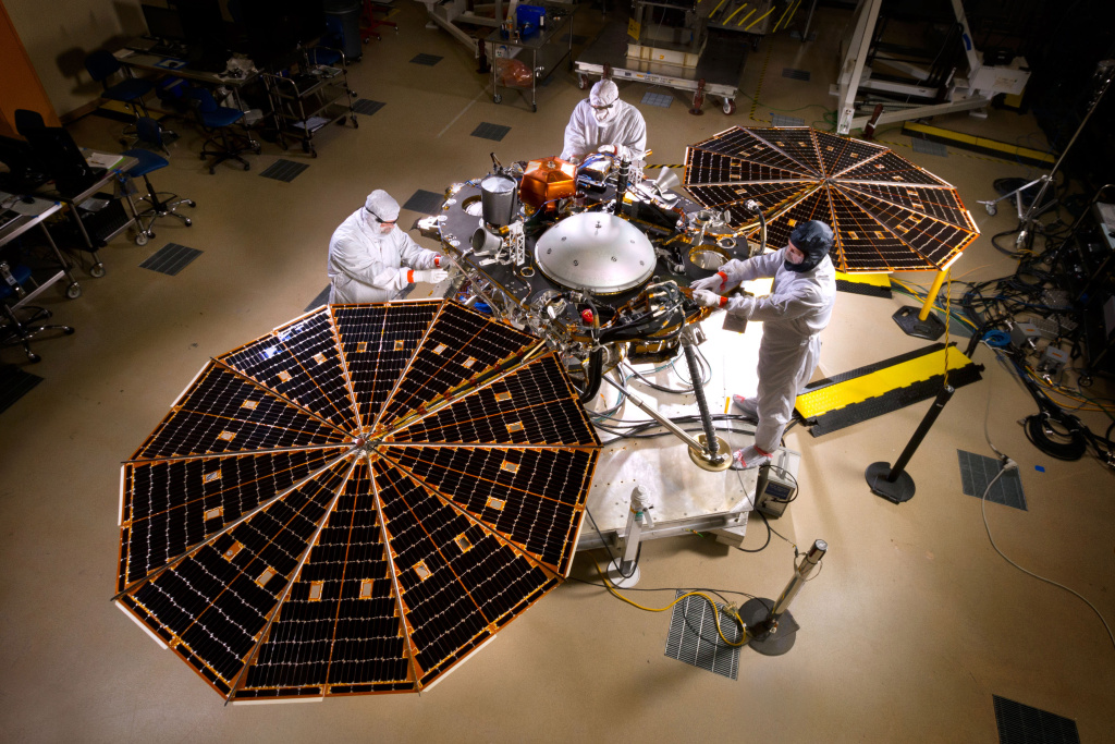 NASA's InSight Mars lander spacecraft in a Lockheed Martin clean room, having deployed its solar arrays as it will on the surface of Mars.