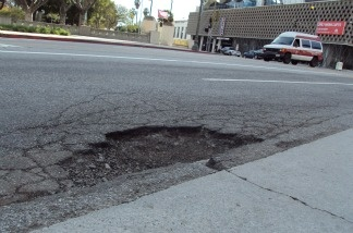 The pothole on Wilshire Boulevard that destroyed KPCC reporter Sanden Totten's front passenger side tire. It has since been filled. But thousands of other holes are still marking up the roads in Los Angeles.
