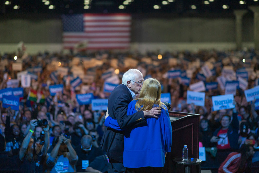 Presidential candidate Sen. Bernie Sanders kisses his wife Jane O'Meara Sanders at his campaign rally at the Los Angeles Convention Center on March 1, 2020 in Los Angeles, California.