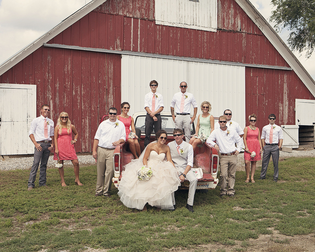 A wedding party poses for a group photo.
