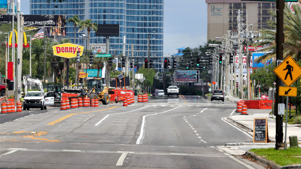 A normally busy intersection in  Orlando is nearly deserted on April 6. Restaurants and retail stores in most of Florida will be allowed to open at limited capacity on Monday.