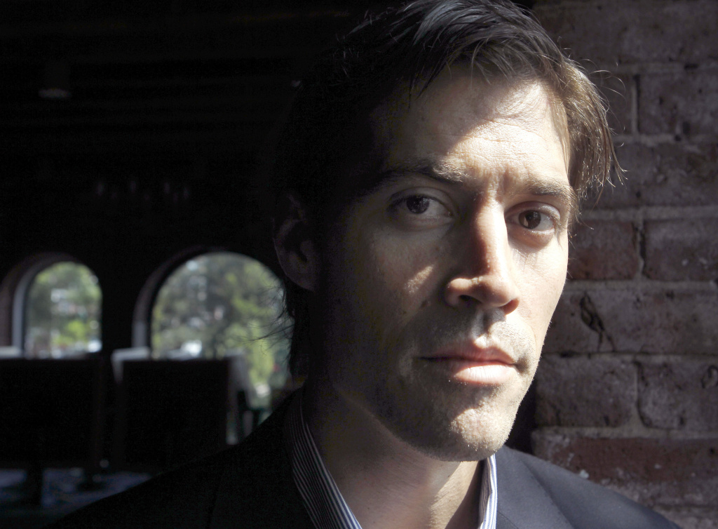 FILE - In this May 27, 2011 file photo, American journalist James Foley, of Rochester, N.H., who was last seen on Nov. 22, 2012 in northwest Syria, poses for a photo in Boston.