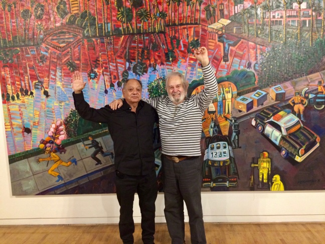 Collector Cheech Marin (left) and Frank Romero in front of the artist's