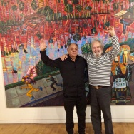 "Collector Cheech Marin (left) and Frank Romero in front of the artist's ""Arrest of the Paleteros"" at the Museum of Latin American Art in Long Beach."