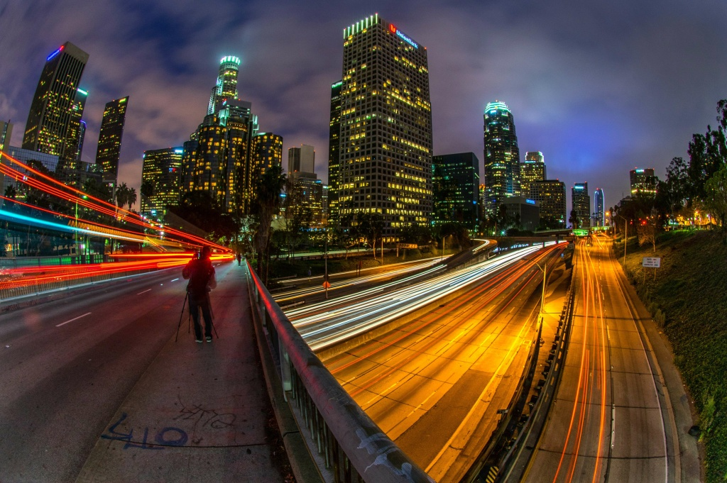 Sunday traffic moves on Interstate Highway 110 at dusk through downtown of Los Angeles on March 23, 2014. JOE KLAMAR/AFP/Getty Images