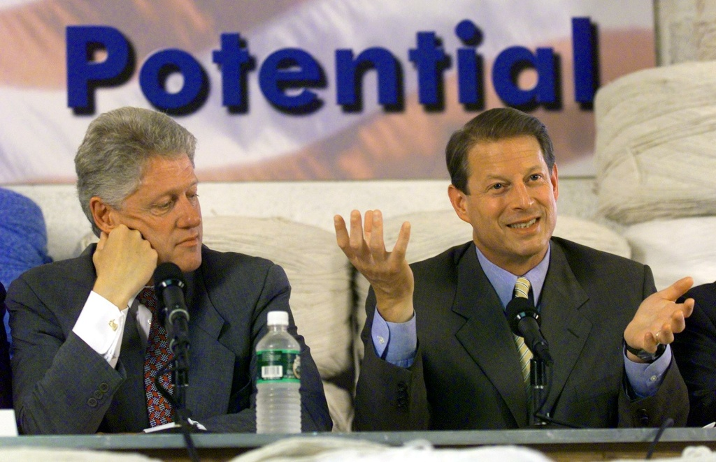 WASHINGTON, :  US President Bill Clinton (L) listens as US Vice-President Al Gore (R) addresses the issues of empowering small business during a Business LINC Roundtable discussion 10 August, 1999, at Powell's Manufacturing Industries in Washington, DC. Clinton recently toured impoverished neighborhoods across the US to promote economic development.           (ELECTRONIC IMAGE)  AFP Photo Paul J. RICHARDS (Photo credit should read PAUL J. RICHARDS/AFP/Getty Images)