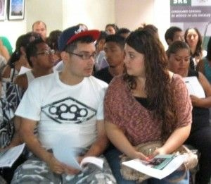 Twenty-year-old Claudia Naranjo, right, consults with her brother, Juan, during a deferred action workshop at the Mexican consulate in Los Angeles, August 14, 2012