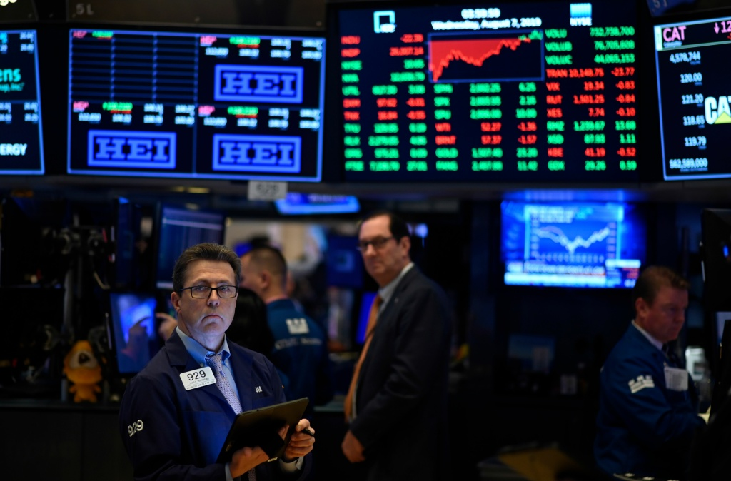 Traders work after the closing bell at the New York Stock Exchange (NYSE) on August 7, 2019 in New York City