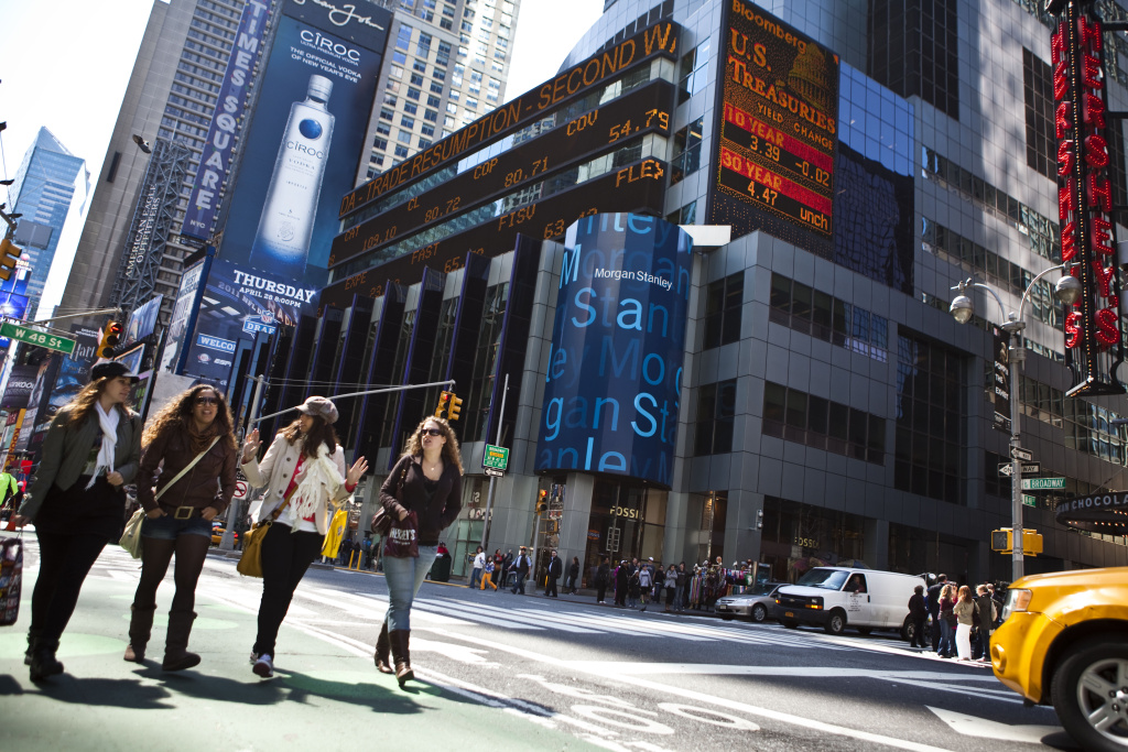 NEW YORK, NY - APRIL 21: Pedestrians cross the street by the Morgan Stanley building in Times Square April 21, 2011 in New York City. Morgan Stanley profits fell 48 percent In the first quarter of 2011. (Photo by Ramin Talaie/Getty Images)