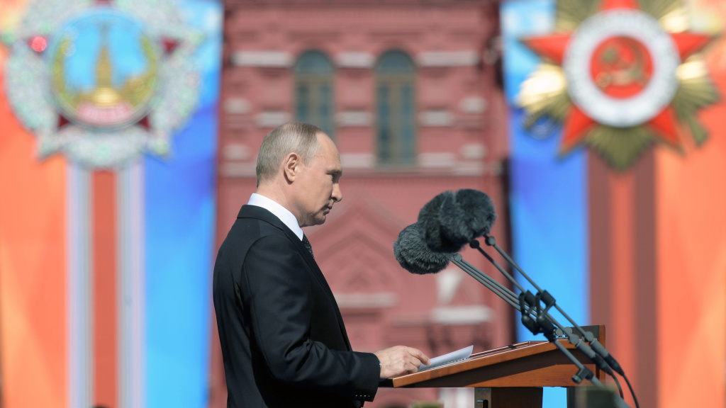 Russian President Vladimir Putin gives a speech during a military parade at Red Square in Moscow on May 9, 2018.
