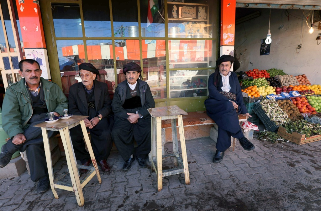 Iraqi Kurdish men sit together outside a tea house in the city of Halabja, about 190 miles northeast of Baghdad, on March 16, 2014. In 1988, Iraqi president Saddam Hussein launched a chemical gas attack on the Kurdish town, killing 5,000 people.