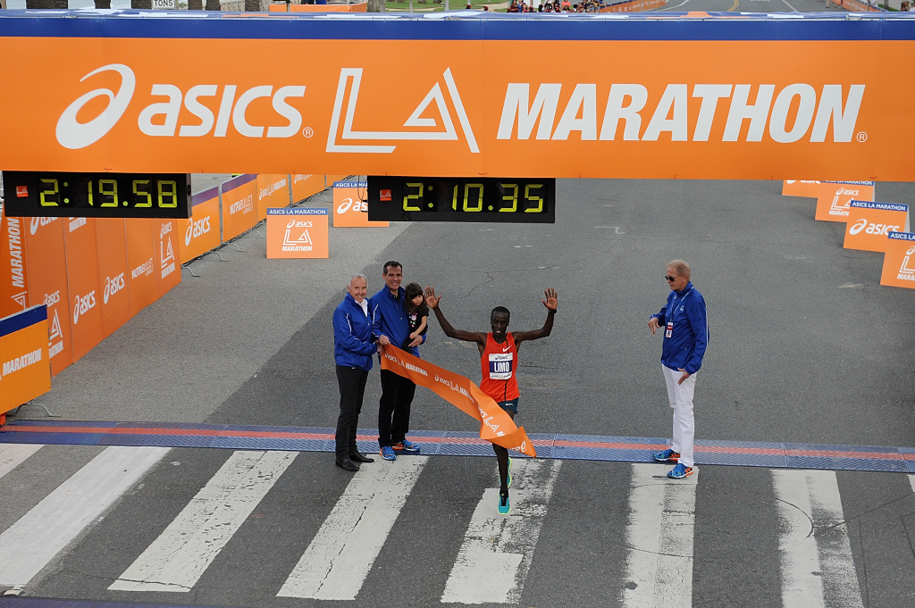 Felix Limo of Kenya crosses the finish line during the 2015 ASICS LA Marathon on March 15, 2015 in Los Angeles, California.