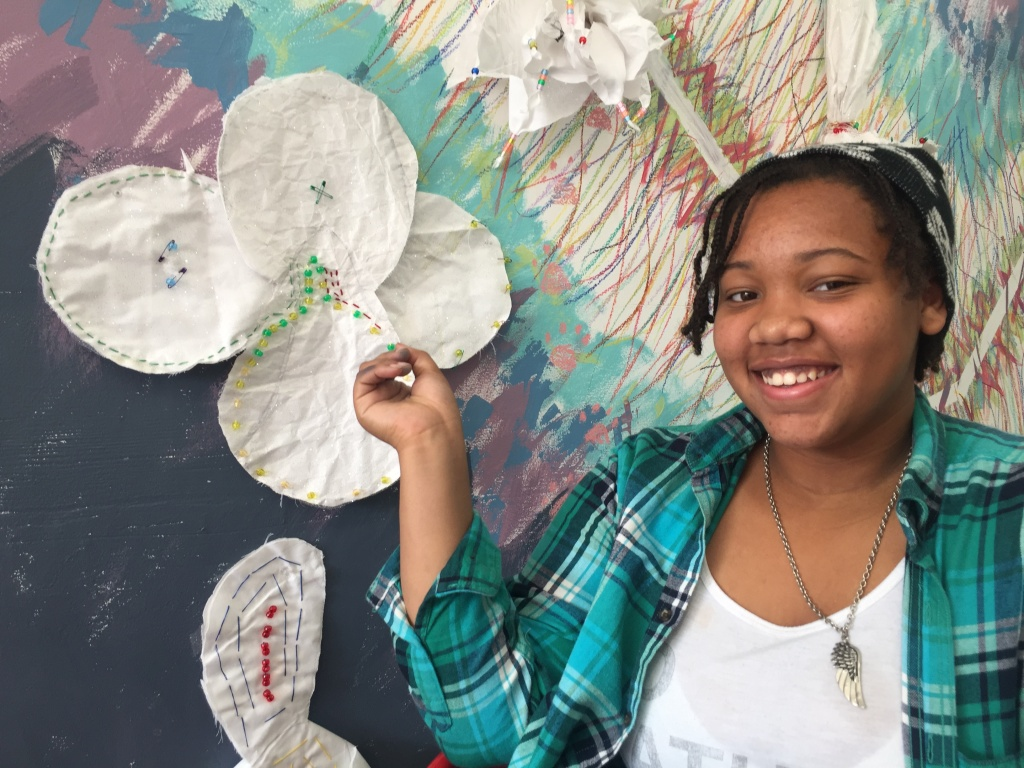Eighth grader Deija Dukes said she was excited to talk to a practicing artist, and to have art displayed in a public exhibition.
