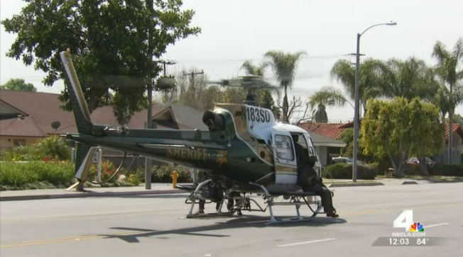 An Orange County Sheriff's Department helicopter helped look for a shooting suspect in Tustin Thursday.