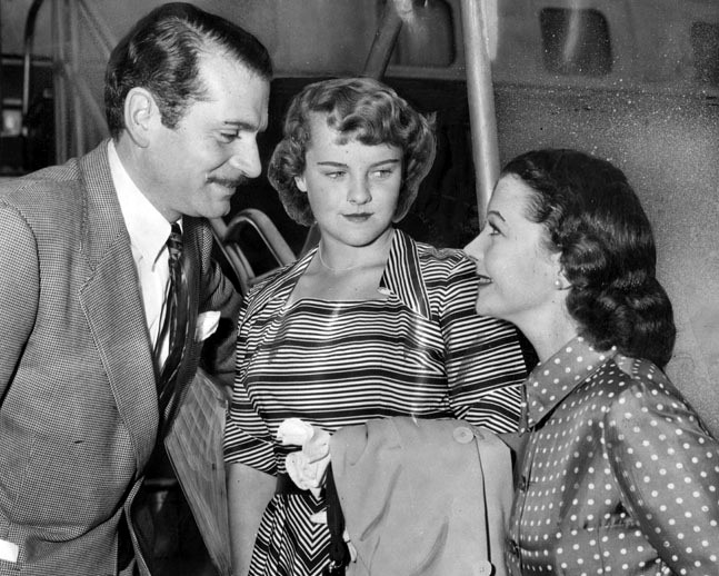 August 14, 1950: Vivien Leigh greets her husband, Laurence Olivier, and daughter, Suzanne Holman, arriving from England.
