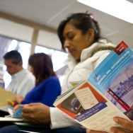 Students at Orange County's Mexican consulate study the California Driver Handbook. With AB-60, California joins 10 other states in allowing undocumented immigrants to apply for driver's licenses.