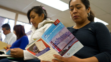 People study the California Driver Handbook at the Mexican consulate in Orange County, Calif. Mexican consulates in California have seen demand for services increase as immigrants apply for special state driver's licenses, and also prepare to apply for immigration relief under executive action. Consulates in the U.S. are accommodating Mexican nationals seeking documents by now providing them with copies of their birth certificates, without their having to leave the country.