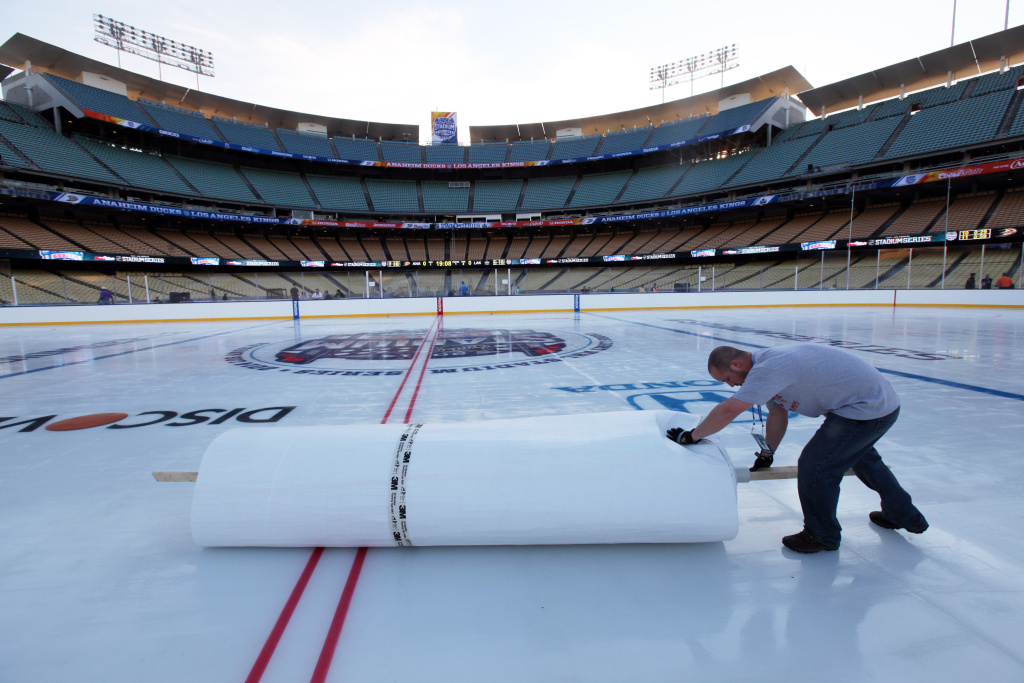 The Los Angeles Kings and Anaheim Ducks played outdoors in a sold-out game at Dodgers Stadium in January 2014. (AP Photo/Nick Ut)