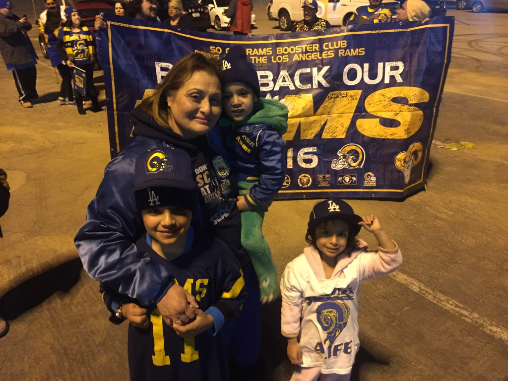 Deborah Retolaza of Covina celebrate the Rams' return with her grandchildren Maxim, Dean, and Jade.