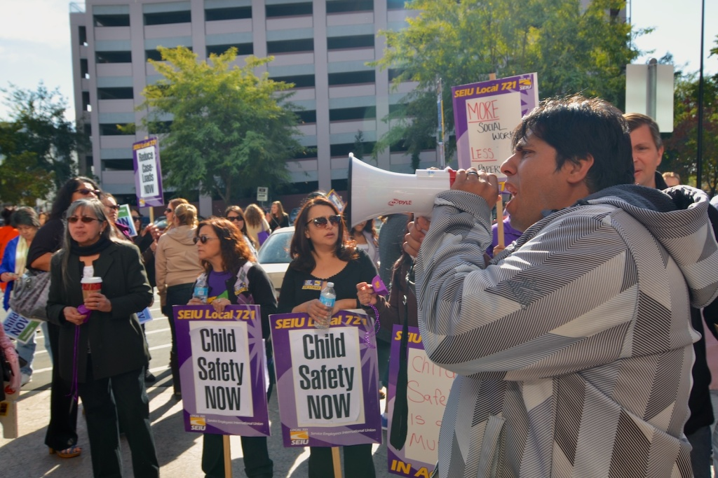 Daniel Marquez leads other social workers in chants outside Supervisor Gloria Molina's office on Monday Dec. 9, when the SEIU and social workers were on strike.