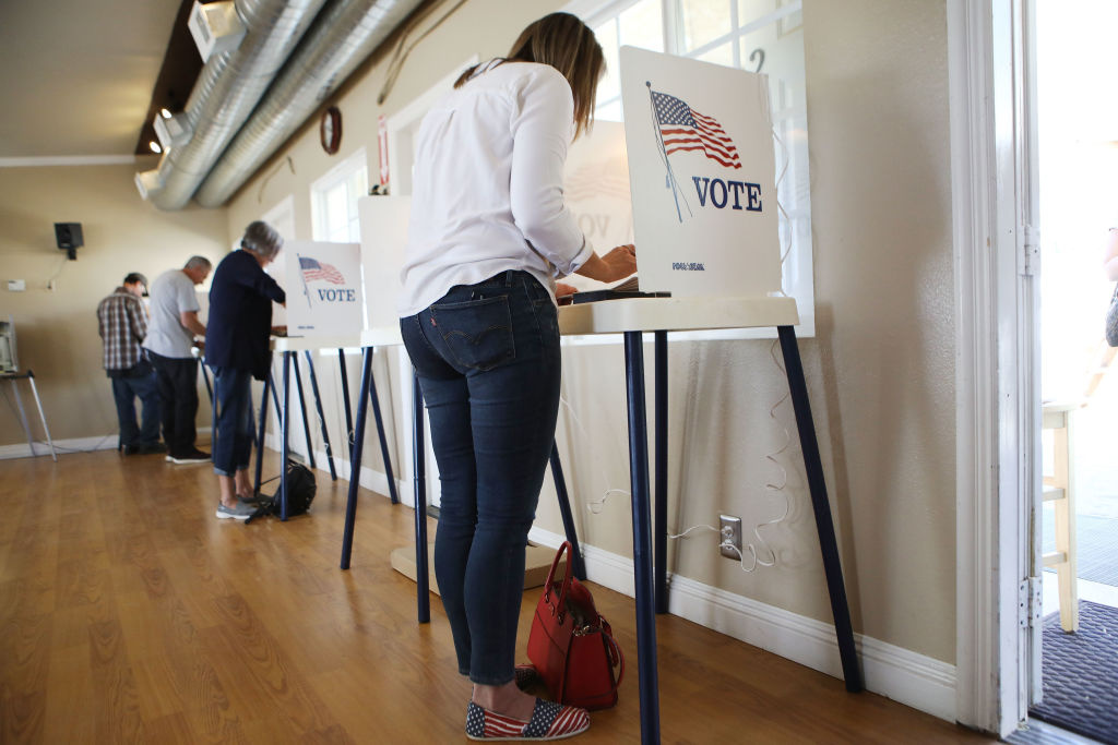 Democratic Congressional candidate Katie Hill fills out her ballot in a polling place in California's 25th Congressional district on November 6, 2018 in Agua Dulce, California.