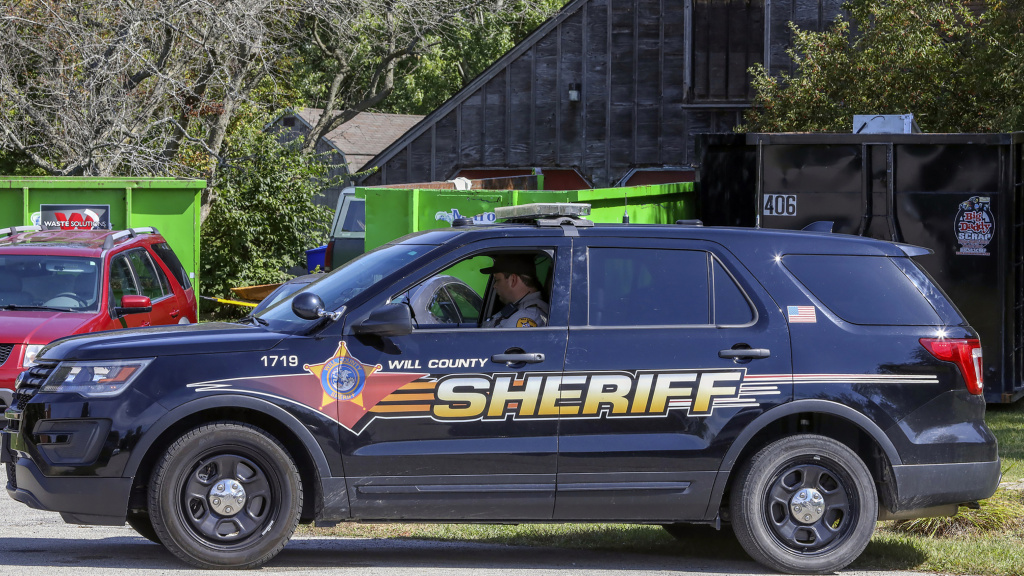 A Will County Sheriff's patrol car is stationed outside the home of deceased Dr. Ulrich Klopfer in unincorporated Crete, Ill., on Sept. 19, 2019. Indiana Attorney General Curtis Hill presided over the mass burial Wednesday of more than 2,400 fetuses found last year at the suburban Chicago home of Klopfer, one of the Midwest's most prolific abortion doctors, days after he died.