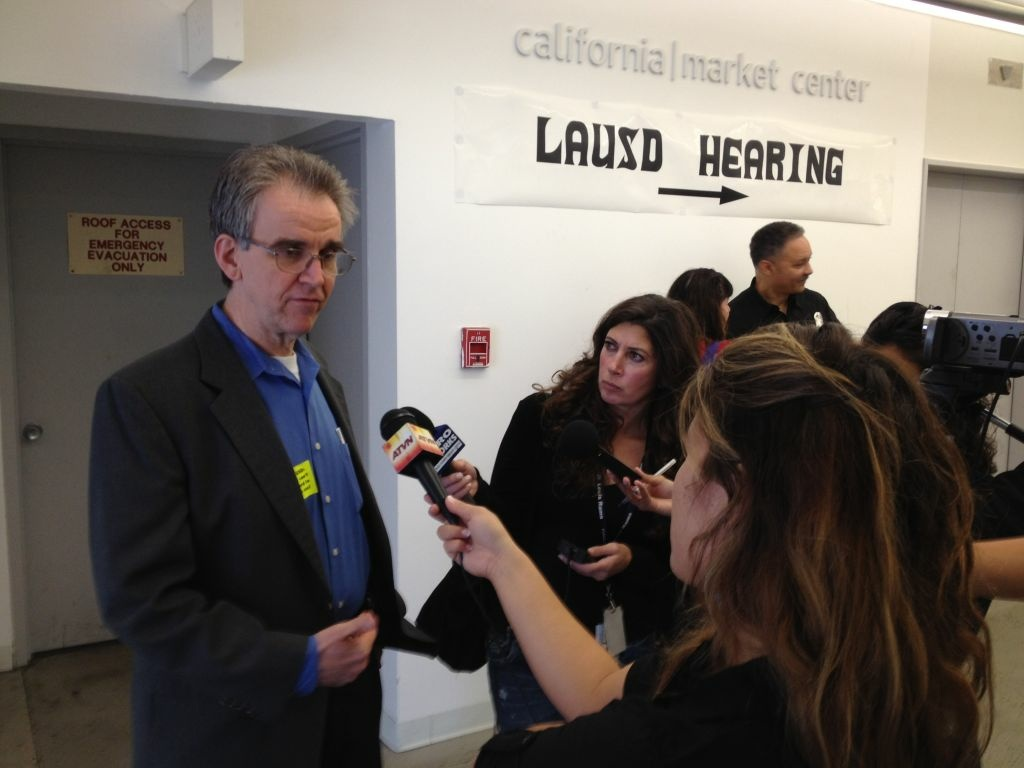 UTLA President Warren Fletcher speaks with reporters at the California Market Center in downtown Los Angeles on the first day of layoff hearings. (April 16, 2012)